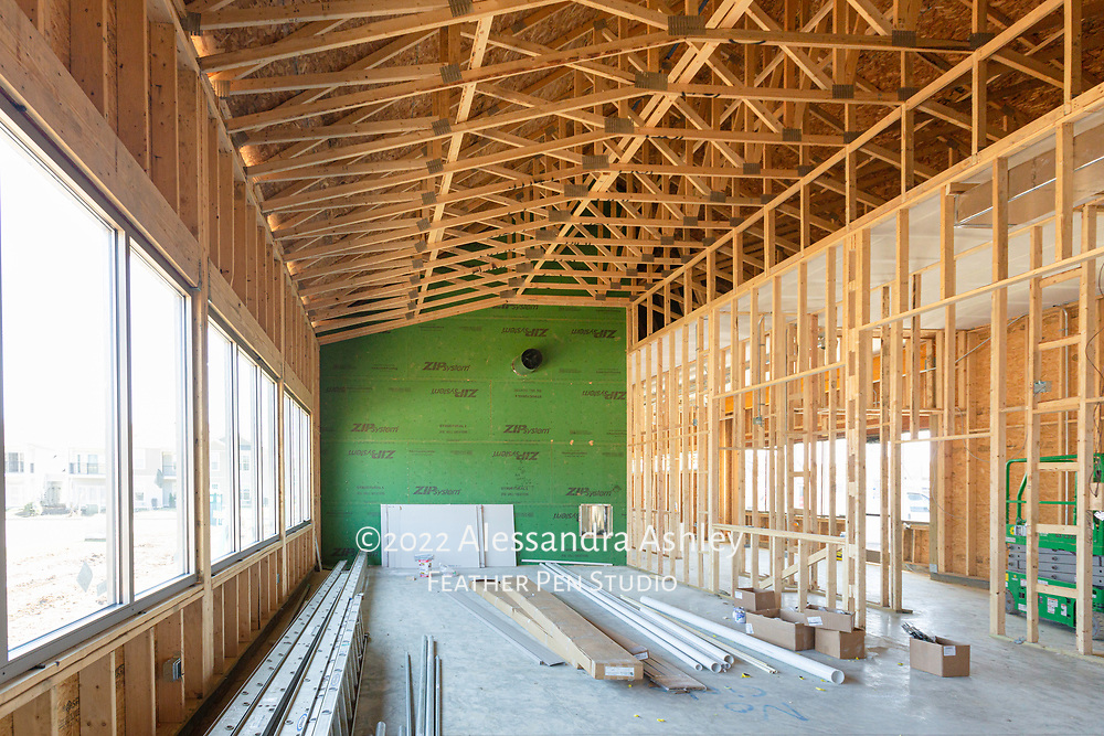 Interior work in progress inside gymnasium room at building site of new physical therapy and wellness center.
