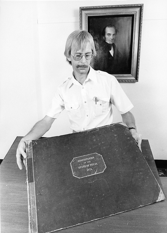 ©1987 Researchers looking at the Texas Constitution in the State Archives.