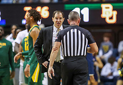 Mar 7, 2020; Morgantown, West Virginia, USA; Baylor Bears head coach Scott Drew talks with an official during the first half against the West Virginia Mountaineers at WVU Coliseum. Mandatory Credit: Ben Queen-USA TODAY Sports