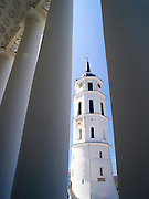 View of the Vilnius Clocktower framed by the columns of the Cathedral/Katedra; Vilnius, Lithuania