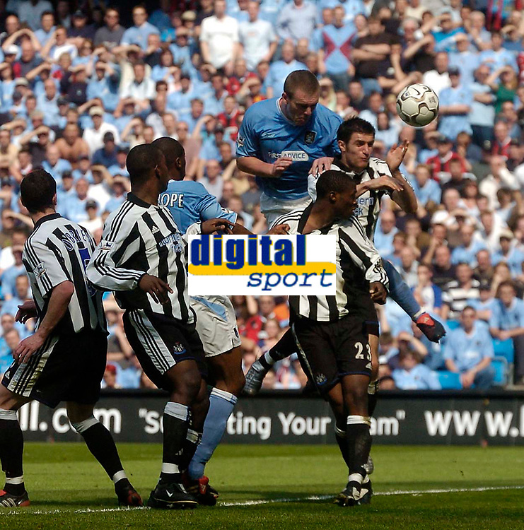 Photo. Glyn Thomas.<br /> <br /> Manchester City v Newcastle United. <br /> <br /> FA Barclaycard Premiership. 01/05/2004.<br /> <br /> Man City's Richard Dunne (third from R) has an excellent chance to head his side ahead blocked by Newcastle keeper Shay Given.