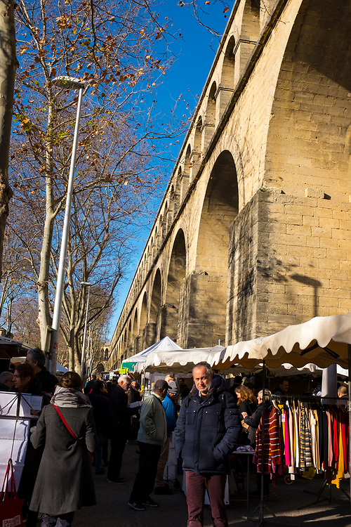 Saturday market at Les Arceaux, Montpellier, France, the neighbourhood dominated by the Saint clément aqueduct.