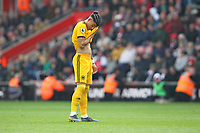 Football - 2018 / 2019 Premier League - Southampton vs. Wolverhampton Wanderers<br /> <br /> Morgan Gibbs-White of Wolverhampton Wanderers wipes his face with his shirt during the Premier League match at St Mary's Stadium Southampton <br /> <br /> COLORSPORT/SHAUN BOGGUST