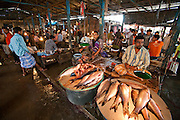 Vendors wait for customers in the busy Sonargaon market in Sonargaon, outside Dhaka, Bangladesh.