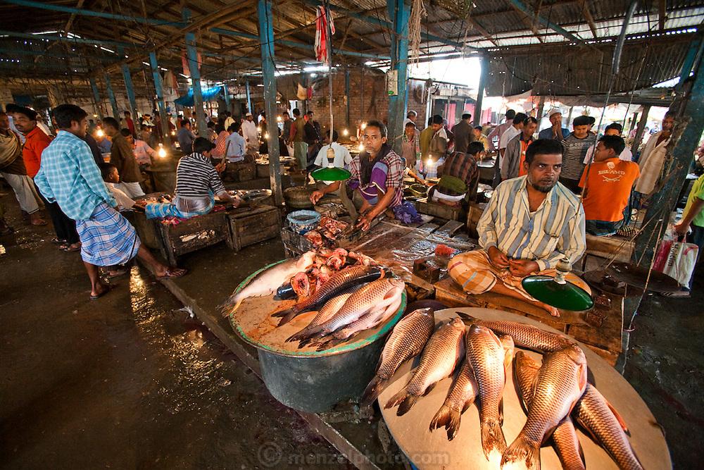 Vendors wait for customers in the busy Sonargaon market in Sonargaon, outside Dhaka, Bangladesh.