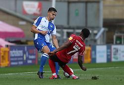 Josh Hare of Bristol Rovers battles with Tayo Edun of Lincoln City - Mandatory by-line: Matt Bunn/JMP - 10/10/2020 - FOOTBALL - LNER Stadium - Lincoln, England - Lincoln City v Bristol Rovers - Sky Bet League One