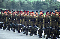 Gurkha soldiers double time march on parade in their ceremonial dress. Slung underneath them are L1A1 SLR's, the standard issue rifle in the British Army throughout the 60's 70's and early 80's. Photograph by Terry Fincher