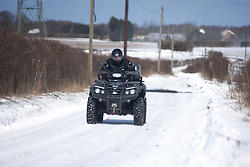 © London News Pictures. 12/03.2013. The village of Yelsted on the North Downs, Kent. Man on an all terrain quad bike travels along a snowy country lane despite overnight snow leaving snowdrifts up to 3 feet deep on the North Downs in Kent. Picture credit should read Manu Palomeque/LNP