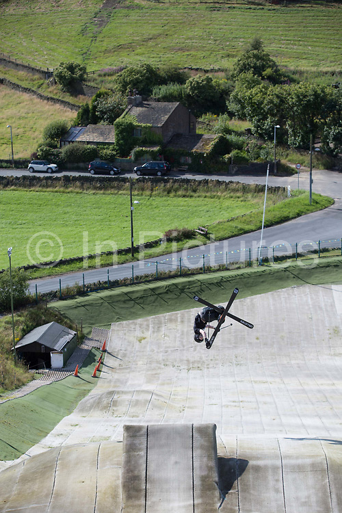 British freestyle skier Tyler Harding skiing the jump at Halifax Ski Centre on 20th July 2017 in Halifax, United Kingdom. Halifax Ski Centre is the spiritual home to many in the UK homegrown ski and snowboard community.