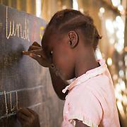 Learning 'L' in Koumbadiouma's primary school. Kolda, Senegal.
