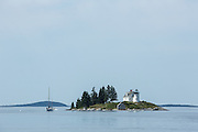 Pumpkin Island, ME -10 August 2014. Pumpkin Island Light, at the northern end of Eggemoggin Reach. The lighthouse is decommissioned, and is in private hands.
