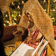 A muslim bride signs the Nikhama in the presence of the Maulvi (priest) and her close family members and relatives. The bride and groom sign the Nikahnama separately and then the couple are pronounced married.