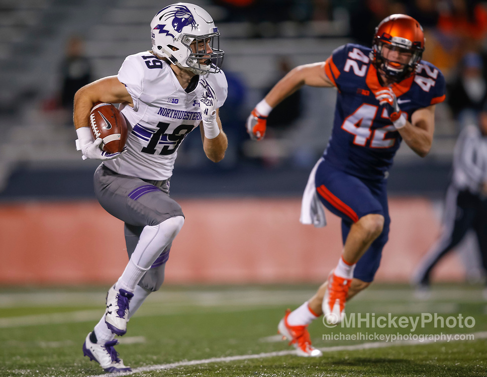 CHAMPAIGN, IL - NOVEMBER 25: Riley Lees #19 of the Northwestern Wildcats runs the ball as Michael Marchese #42 of the Illinois Fighting Illini pursues at Memorial Stadium on November 25, 2017 in Champaign, Illinois. (Photo by Michael Hickey/Getty Images) *** Local Caption *** Riley Lees; Michael Marchese
