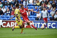 Anthony Pilkington of Cardiff city ®  has a shot. Skybet football league championship match, Cardiff city v Sheffield Wed at the Cardiff city stadium in Cardiff, South Wales on Saturday 27th Sept 2014<br /> pic by Andrew Orchard, Andrew Orchard sports photography.
