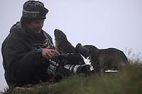 Photographer with Alpine Marmot (Marmota marmota) (model release 02/08/HTNP), Hohe Tauern National Park, Carinthia, Austria