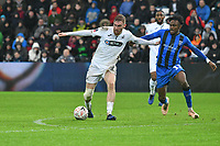 Football - 2018 / 2019 Emirates FA Cup - Fourth Round: Swansea City vs. Gillingham<br /> <br /> Oliver McBurnie of Swansea City on the attack challenged by Regan Charles-Cook of Gillingham, at Liberty Stadium.<br /> <br /> COLORSPORT/WINSTON BYNORTH