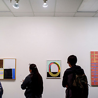 """Gallery patrons look over the work of artist Mick Burson during the final day of his show """"Milk"""" at the Ingham Chapman Gallery at UNM-Gallup Tuesday."""