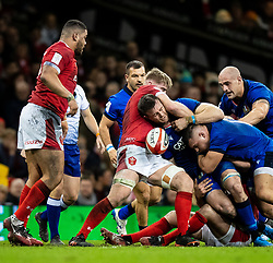 Braam Steyn of Italy loses the ball under pressure from Aaron Wainwright of Wales<br /> <br /> Photographer Simon King/Replay Images<br /> <br /> Six Nations Round 1 - Wales v Italy - Saturday 1st February 2020 - Principality Stadium - Cardiff<br /> <br /> World Copyright © Replay Images . All rights reserved. info@replayimages.co.uk - http://replayimages.co.uk