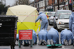 © Licensed to London News Pictures. 09/04/2019. London, UK. A crime scene investigator enter the police tent on Church Road, Manor Park, East London where a man in his 20s was shot and stabbed to death on Monday 8 April 2019. Police were called around 9.30pm and the man was was found with knife and gunshot wounds. The victim was pronounced dead at the scene. <br /> . Photo credit: Dinendra Haria/LNP