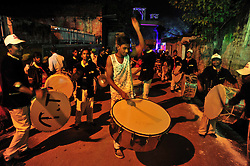 September 26, 2016 - Allahabad, Uttar Pradesh, India - Allahabad: Traditional drum players performs during a religious procession Ravan ki Barat in Allahabad on September 26, 2016, held to mark the Dussehra festival. The name Dussehra is derived from Sanskrit Dasha-hara literally means removal of ten referring to Lord Rama's victory over the ten-headed demon king Ravana. Dussehra is celebrated on the tenth day of the month of Ashwin according to the Hindu calendar which corresponds to September or October of the Gregorian calendar. (Credit Image: © Prabhat Kumar Verma via ZUMA Wire)