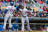 Ike Davis #29 of the New York Mets congratulates teammate Marlon Byrd #6 after Byrd's home run during a game against the Minnesota Twins on April 13, 2013 at Target Field in Minneapolis, Minnesota.  The Mets defeated the Twins 4 to 2.  Photo: Ben Krause