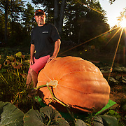 Andrew Vial sits with his Atlantic Giant pumpkin growing at his home in Liberty, North Carolina. Vial grows giant produce and shows them around the south. Nathan Lambrecht/Journal Communications