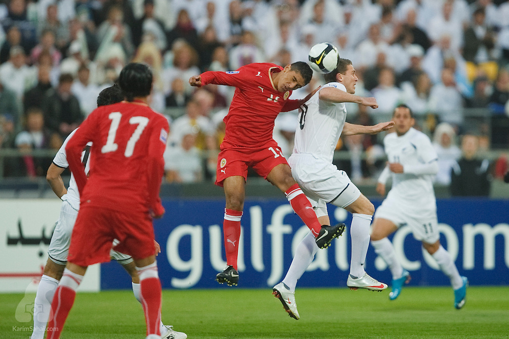 Faouzi Mubarak Aaish of Bahrain and All Whites midfielder Tim Brown battle for the ball, during the second leg of the 2010 FIFA World Cup qualifying game in front a record 35,194 football fans at Westpac Stadium on November 14, 2009. New Zealand beat Bahrain 1-0 and secured a spot at the 2010 World Cup in South Africa.