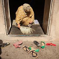 Sweeping the threshold at the home of Hamdan Ali Hous in Jabal Akhdar.