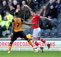 Lee Tomlin of Bristol City is challenged for the ball by Moses Odubajo of Hull City - Mandatory by-line: Dougie Allward/JMP - 02/04/2016 - FOOTBALL - KC Stadium - Hull, England - Hull City v Bristol City - Sky Bet Championship
