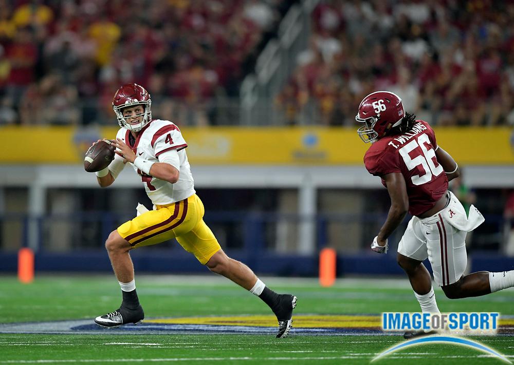 Sep 3, 2016; Arlington, TX, USA; USC Trojans quarterback Max Browne (4) runs away from Alabama Crimson Tide linebacker Tim Williams (56) during the first half at AT&T Stadium.