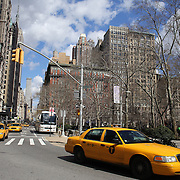 A Manhattan street scene showing yellow taxi cabs. Manhattan, New York, USA. 26th March 2013. Photo Tim Clayton