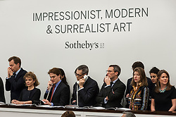 © Licensed to London News Pictures. 03/03/2016. London, UK.  Sotheby's staff on the telephone to clients at Sotheby's Impressionist, Modern & Surrealist art evening sales in New Bond Street.  The combined total of the sale was forecast to realise between £97-138m. Photo credit : Stephen Chung/LNP