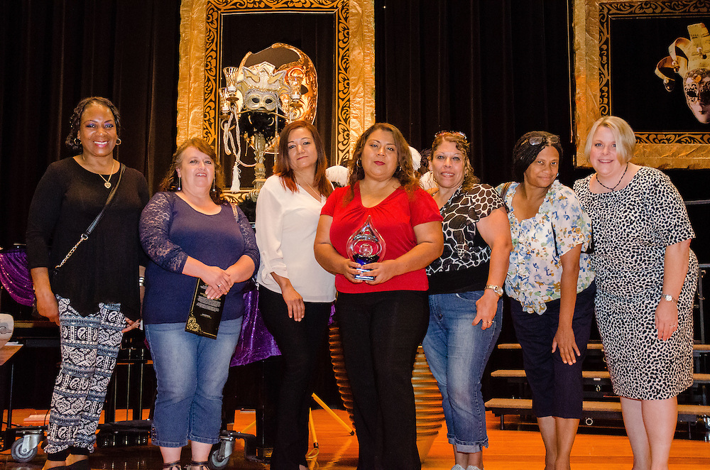 Director of Nutrition Services (right) Jennifer Boesch presents Cage Elementary School staff with their cafeteria of the year trophy in the elementary school division.