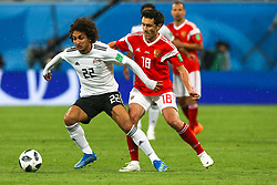 June 19, 2018 - Saint Petersburg, Russia - Amr Warda (L) of the Egypt national football team and Yury Zhirkov of the Russia national football team vie for the ball during the 2018 FIFA World Cup match, first stage - Group A between Russia and Egypt at Saint Petersburg Stadium on June 19, 2018 in St. Petersburg, Russia. (Credit Image: © Igor Russak/NurPhoto via ZUMA Press)