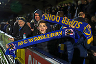 AFC Wimbledon fan holding scarf during the The FA Cup match between AFC Wimbledon and West Ham United at the Cherry Red Records Stadium, Kingston, England on 26 January 2019.