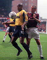 Sylvian Wiltord (Arsenal) Nigel Winterburn (West Ham United). West Ham United 1:2 Arsenal. 21/10/2000. Credit: Colorsport / Stuart MacFarlane.