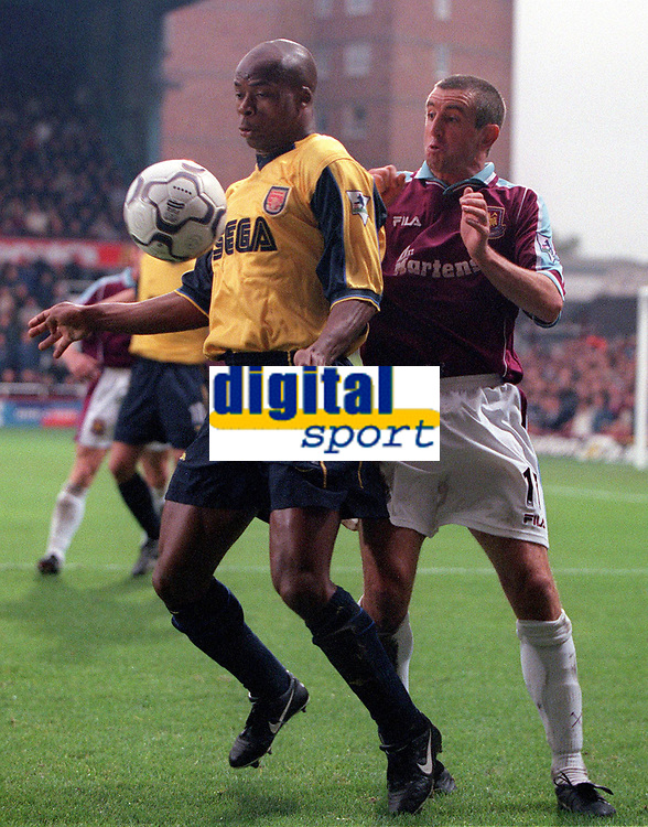 Sylvian Wiltord (Arsenal) Nigel Winterburn (West Ham United). West Ham United 1:2 Arsenal. 21/10/2000. Credit: Colorsport / Stuart MacFarlane.
