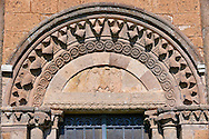 13th century Romanesque decorative archivolts and lunette with a sculpted eagle of the 8th century Romanesque Basilica church of St Peters, Tuscania, Lazio, Italy .<br /> <br /> Visit our ITALY PHOTO COLLECTION for more   photos of Italy to download or buy as prints https://funkystock.photoshelter.com/gallery-collection/2b-Pictures-Images-of-Italy-Photos-of-Italian-Historic-Landmark-Sites/C0000qxA2zGFjd_k