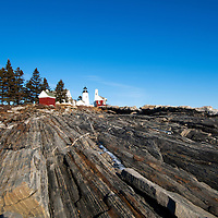 View along the rocky coastline of Pemaquid Lighthouse Park at low tide. Built in 1827.