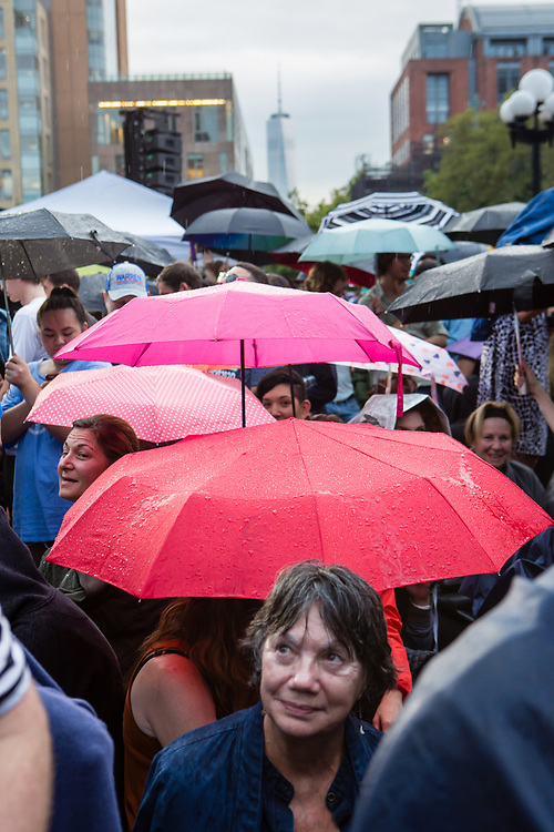 """New York, NY – 16 September 2019. Massachusetts Senator and Democratic Presidential candidate Elizabeth Warren drew a large and enthusiastic crowd at a speech for her increasingly popular 2020 presidential campaign in New York's Washington Square. A light rain fell prior to her speech, and as umbrellas popped open, soneone said """"we have a plan for that,"""" echoing Warren's frequently used phrase."""