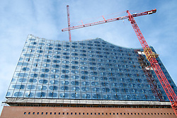 New Opera House under construction at Hafencity modern property development in Hamburg Germany