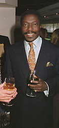 PRINCE ALBERT ESIRI he is the son of a Kenyan tribal chief, at a party on April 22nd 1997.LXW 26 MO