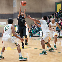 In Newcomb, Deontay Begay (15) and Tracy Bryant (40) of Newcomb try to defend Farrell Chavez (22) of Tse Yi Gai who passes into the post. Newcomb won 83-49 on Saturday.