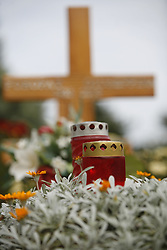 Candles on  a grave.  (Photo by: Vid Ponikvar / Sportal Images).