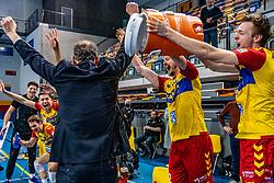 Jeroen Rauwerink of Dynamo, Nico Manenschijn of Dynamo, Coach Redbad Strikwerda of Dynamo celebrate after 3-1 win in the last final league match between Draisma Dynamo vs. Amysoft Lycurgus on April 25, 2021 in Apeldoorn.