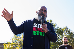 London, UK. 2 September, 2019. Asad Rehman, Executive Director of War on Want, addresses activists outside ExCel London on the first day of week-long protests against DSEI 2019, the world's largest arms fair.