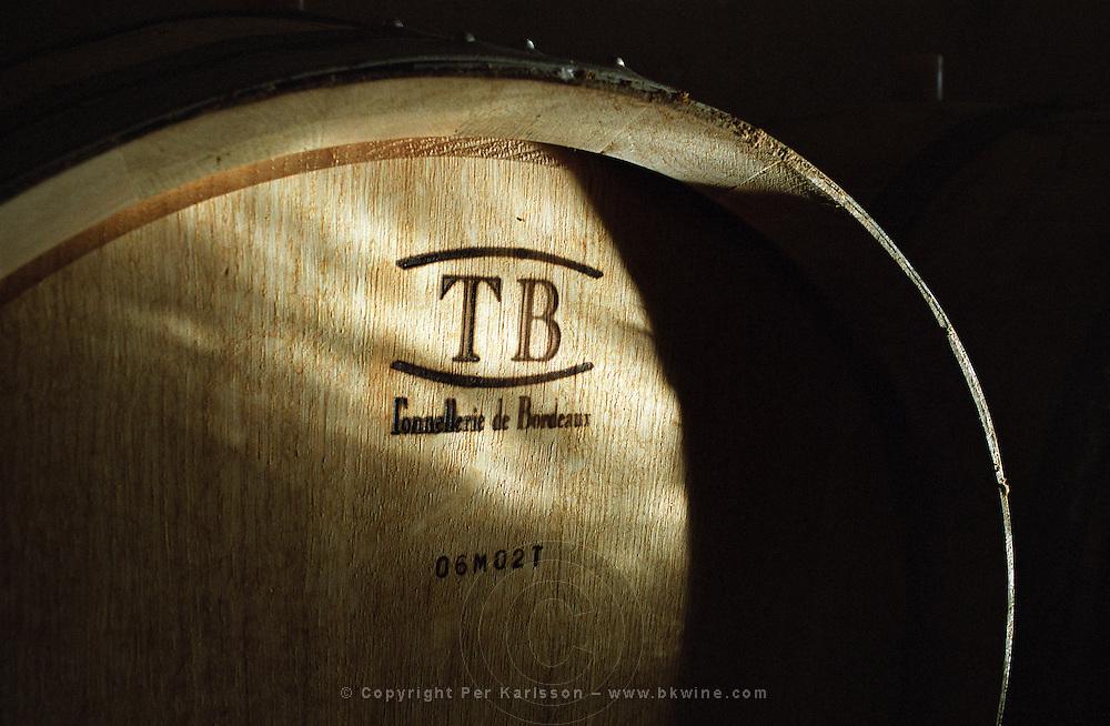 Oak barrel aging and fermentation cellar. Chateau Plaisance, Premieres Cotes de Bordeaux, France
