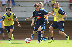 04.08.2014, Athletic Area, Schladming, AUT, Hertha BSC, im Bild von links Hajime Hosogai (Hertha BSC, #7), Valentin Stocker (Hertha BSC, #14), Peter Niemeyer (Hertha BSC, #18), John Heitinga (Hertha BSC, #5) // during a training session of the German Bundesliga Club Hertha BSC at the Athletic Area, Austria on 2014/08/04. EXPA Pictures © 2014, PhotoCredit: EXPA/ Martin Huber