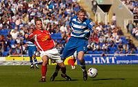 Photo: Alan Crowhurst.<br />Reading v Crewe Alexandra. Coca Cola Championship.<br />17/09/2005. Crewe's Gary Roberts (L) challenges with Ibrahima Sonko of Reading.
