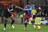 Scott Laird of Scunthorpe United and Donervon Daniels of Wigan Athletic fight for ball  during the Sky Bet League 1 match between Scunthorpe United and Wigan Athletic at Glanford Park, Scunthorpe, England on 2 January 2016. Photo by Ian Lyall.